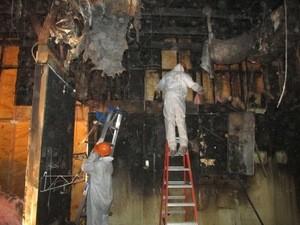 Water Damage Restoration Technicians Inspecting Water Leaks