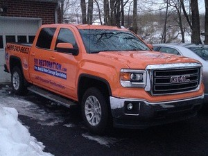 Water-Damage-Restoration-Truck-At-Winter-Flooding-Site