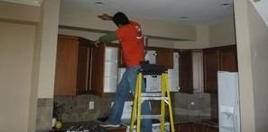 Water damage Chester Technician performing ceiling work